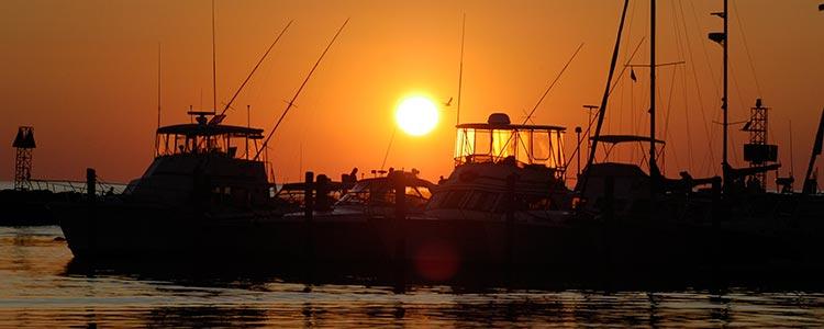 ocean sunset boats