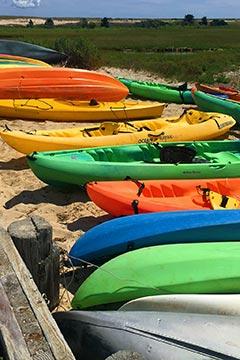 colorful kayaks on beach of Martha's Vineyard