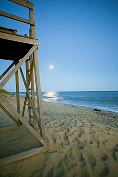 Edgartown Katama beach lifeguard stand, ocean and moon in the summer