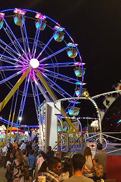 Martha's Vineyard Agricultural Fair ferris wheel lights up the night
