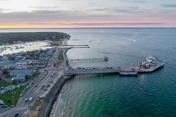 oak bluffs downtown, ferry dock and Seaview Ave OB harbor drone view at sunset in summer