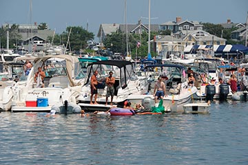 Oak Bluffs harbor mooring July 4th boats people swimming partying in summer