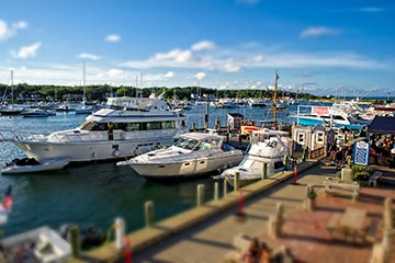 Oak Bluffs harbor boats, boardwalk in the summer