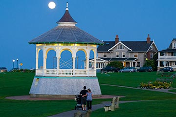 family walking around Oak Bluffs Ocean Park gazebo full moon night