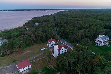 West Chop lighthouse and Vineyard Sound at dusk drone photo in the summer