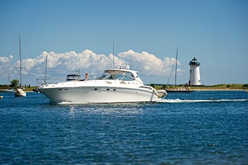 Edgartown Lighthouse and yachts in the summer