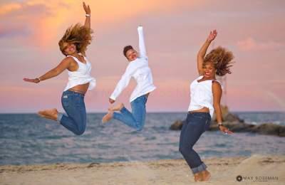 girls having fun jump on the beach